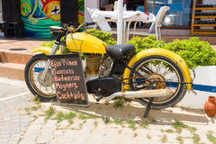 Old bike and the price of drinks in the restaurant on the waterfront. Royalty Free Stock Photography