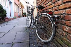Old bike standing at the  wall. A bike standing at the brick wall in Bremen, Germany Royalty Free Stock Photography