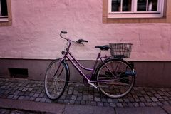 Old bike standing at the  wall Stock Images