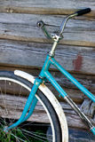 Old bike stands near the wooden wall Royalty Free Stock Images