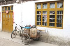 Retro carrier cycle in unspoiled town Daxu, near Guilin, China. Very old carier cycle is an important means of city transport in the old town Daxu near Guilin in Royalty Free Stock Image