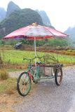 Alternative transport by retro carrier cycle taxi with parasol, Yangshuo, China Royalty Free Stock Photography