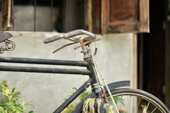 Old bike. Vintage old bike front of house Stock Image