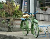 Old Bike Waits for Winter Storage. On Small Town Sidewalk Stock Images