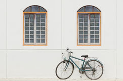Old bike and wall Stock Photo