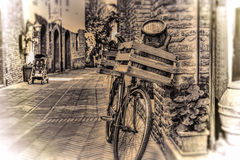 Old bike with wooden case against a brick wall in sepia tone Stock Photography