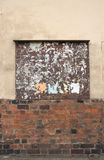 Old Billboard on wall. Old billboard with torn posters on brick and stucco wall. Vintage mock up for art work Royalty Free Stock Photos
