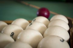 Old billiard balls. On a table with green cloth royalty free stock photo