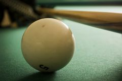 Old billiard balls. On a table with green cloth stock photography