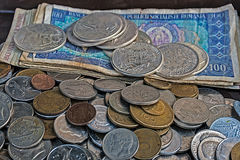 Old bills and coins of different nationalities Royalty Free Stock Photo