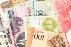Old bills from various exotic countries. Colorful money background. Close-up macro stock photo