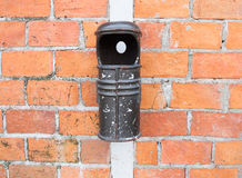 Old bin and brick wall Royalty Free Stock Images