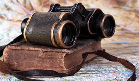 Old binocular with antique book Stock Photos