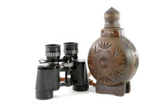 Old binocular and wooden bottle Stock Photo