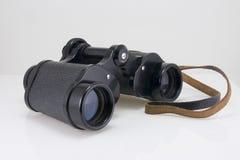 Old binoculars. A pair of binoculars on white Royalty Free Stock Image