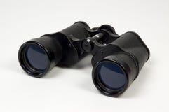 Old binoculars. Close-up of old binoculars on white background stock photo