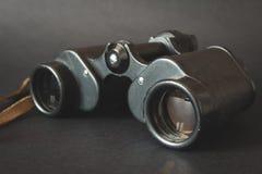 Old binoculars on black background Stock Images
