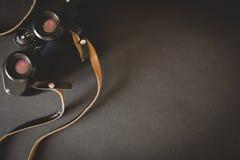 Old binoculars on black background Royalty Free Stock Image
