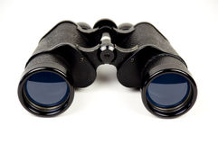 Old binoculars front view. Close-up of old binoculars with blurred background on white stock photography