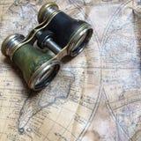 Old binoculars on a vintage map Stock Photo