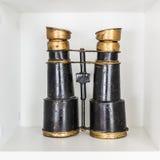 Old binoculars on white shelf Royalty Free Stock Image