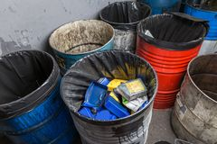 Old bins of oil Stock Photo