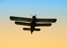 Old biplane. Bottom view of vintage military airplane in flight Stock Image