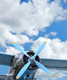 Old biplane against sky. Old biplane against blue sky, vintage background, close up Royalty Free Stock Photography