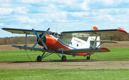 Old biplane. Old biplane aircraft in the airport Royalty Free Stock Image