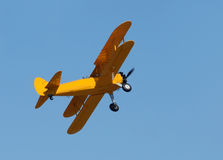 Old biplane in flight Stock Photos