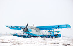 Old biplane on the ground in winter Royalty Free Stock Photography