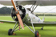 Old biplane. Silver biplane from 1930:ies Stock Image