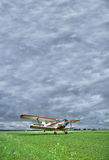 Old biplane takeoff under the storm Royalty Free Stock Photo