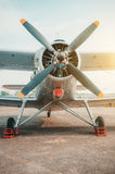 Old biplane, turboprop aircraft in the parking lot. Stock Photo