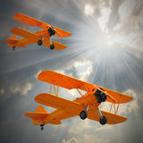 Old Biplanes. Retro style picture with aviation theme Royalty Free Stock Images