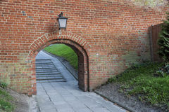 Old birck wall - entry to Cathedral, Frombork, Poland. Stock Images
