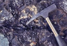 Old bitumen with claw hammer royalty free stock photos