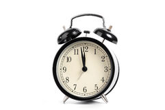 Old black alarm clock. Isolated on a white background Royalty Free Stock Photo