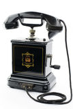 Old black antique telephone with handle Royalty Free Stock Images