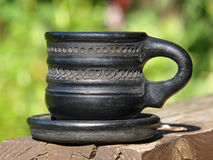 Old black arabian ceramic cup taken closeup. Stock Images