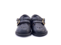 Old black Baby shoe made from leather Royalty Free Stock Image