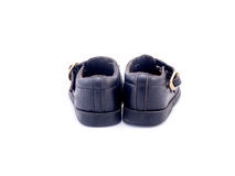 Old black Baby shoe made from leather Royalty Free Stock Photos