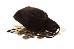 Old black bag money. Old black bag with money coins isolated on white background Royalty Free Stock Images