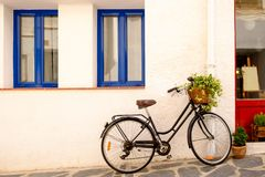 Old black bicycle. Against a white wall Royalty Free Stock Photo