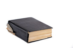 Old black book. Old black covered closed book against white background Royalty Free Stock Image