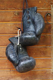 Old black boxing gloves Stock Photos