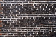 Old black brick wall background texture. Close up Royalty Free Stock Photography