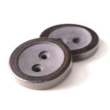 Old black buttons isolated on white background Stock Image
