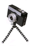 Old black camera on a tripod Royalty Free Stock Image