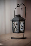 Old black candle lamp on the table. At home with two wedding rings Royalty Free Stock Photos